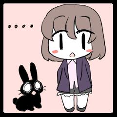 Girl and black rabbit
